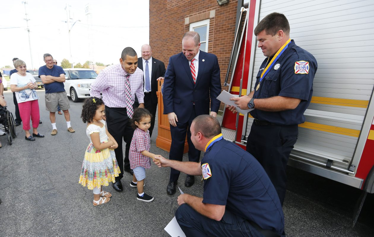 Lackawanna Firefighters Brian Murphy, left, and Nick Kasprzak, right, receive the Liberty Medal, the state's highest civilian honor, from Zainab Soliman, left, and her brother Zaid, along with their uncle Yaser Soliman, Lackawanna Mayor Geoff Szymanski, and State Senator Tim Kennedy during a ceremony at the #3 station in Lackawanna Wednesday, Sept. 20, 2017.  (Mark Mulville/Buffalo News)