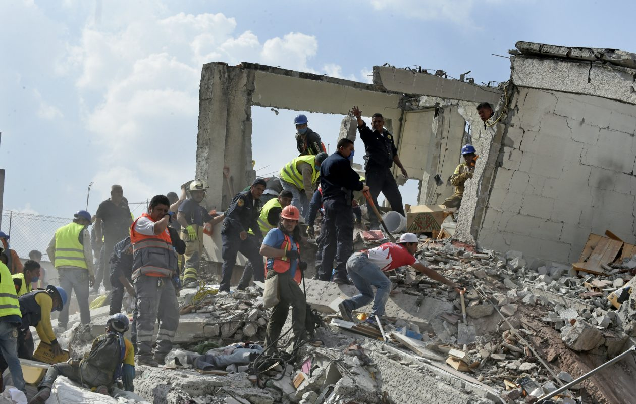 Rescuers work searching for survivors amid the rubble of a collapsed building after a powerful quake in Mexico City on September 19, 2017. A powerful earthquake shook Mexico City on Tuesday, causing panic among the megalopolis' 20 million inhabitants on the 32nd anniversary of a devastating 1985 quake. The US Geological Survey put the quake's magnitude at 7.1 while Mexico's Seismological Institute said it measured 6.8 on its scale. The institute said the quake's epicenter was seven kilometers west of Chiautla de Tapia, in the neighboring state of Puebla. (Getty Images)