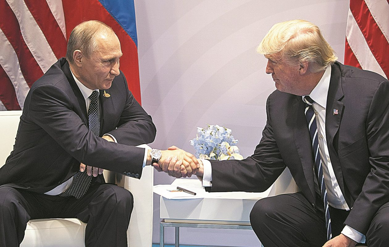 President Donald Trump and President Vladimir Putin of Russia shake hands in a meeting during the G-20 summit in Hamburg, Germany, July 7, 2017. (Stephen Crowley/The New York Times)
