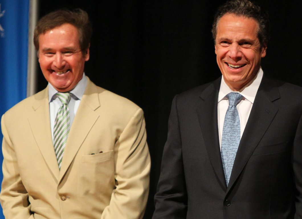 Congressman Brian Higgins and Gov. Andrew Cuomo share a laugh while announcing that Roswell Park had retained a grant in an event at the hospital in Buffalo on July 1, 2014. (Mark Mulville/Buffalo News)