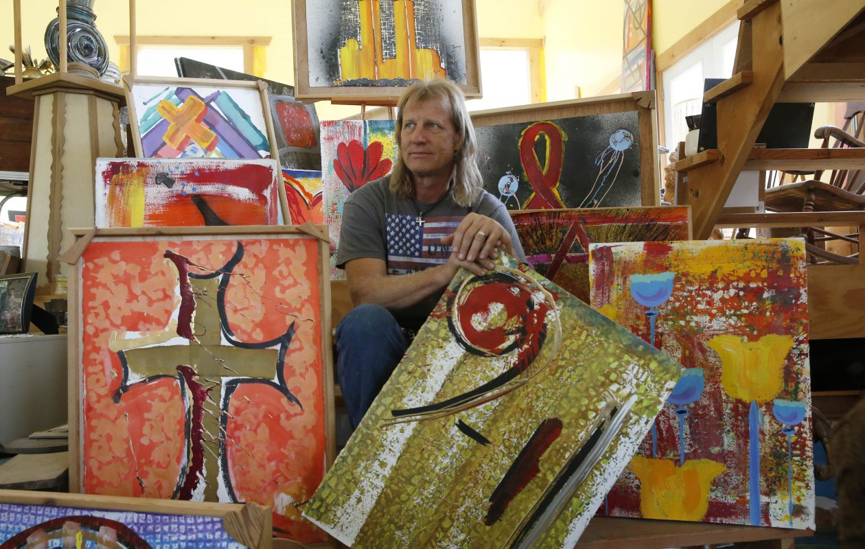 Artist Richard Sean Manning, of Lockport, is on a mission to create 3,000 paintings representing the victims of the 9/11 attacks.  He's finished 1,800 so far. Photo taken with a handful of the painings. in his studio, Sunday, Sept. 10, 2017.  (Sharon Cantillon/Buffalo News)