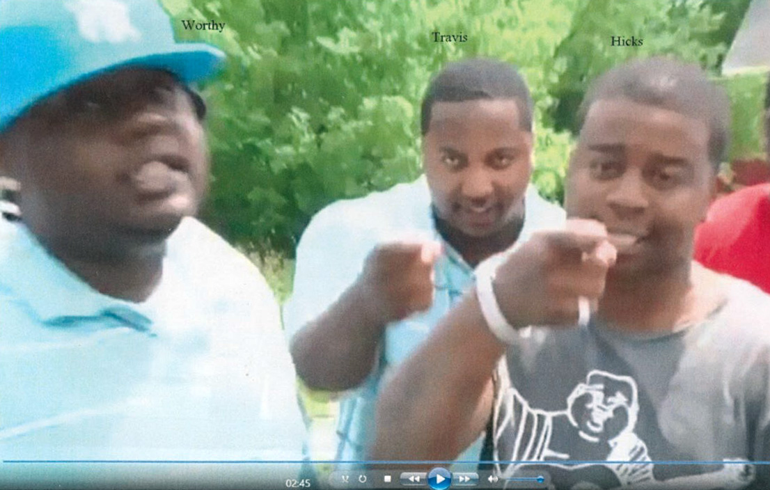 A still from two rap music videos that prosecutors say is proof of an organized street gang called the Schuele Boys.