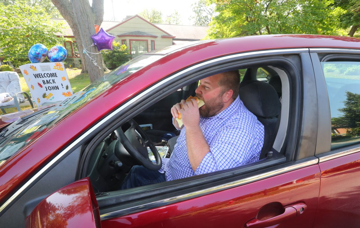 John Pawlowski chomps on a sub during his triumphant return as the Tonawanda sub eater, at his regular spot on  Zimmerman Boulevard in Tonawanda, N.Y., on  Wednesday,  Sept. 20, 2017. (John Hickey/Buffalo News)