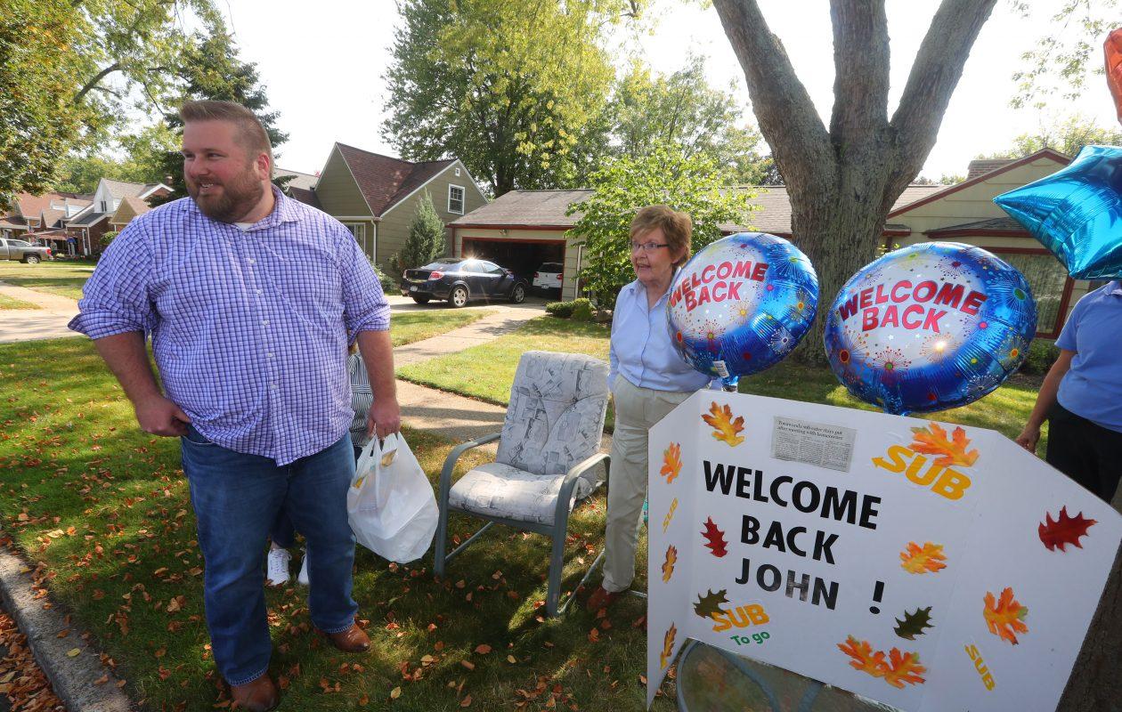 Barbara Tucker  gives a warm welcome to John Pawlowski on his triumphant return to his regular Zimmerman Boulevard lunch spot  in Tonawanda. (John Hickey/Buffalo News)