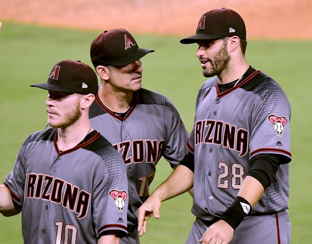 Arizona manager Torey Lovullo (middle) greets J.D. Martinez after the Diamondbacks' 13-0 win Monday in Los Angeles that was led by Martinez's four home runs (Getty Images).
