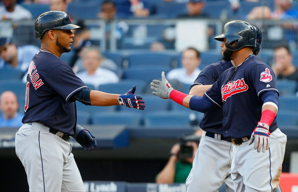 The Cleveland duo of Edwin Encarnacion, left, and Carlos Santana shake on it after they both scored in the second game of Wednesday's double-header sweep by the Indians in New York (Getty Images).