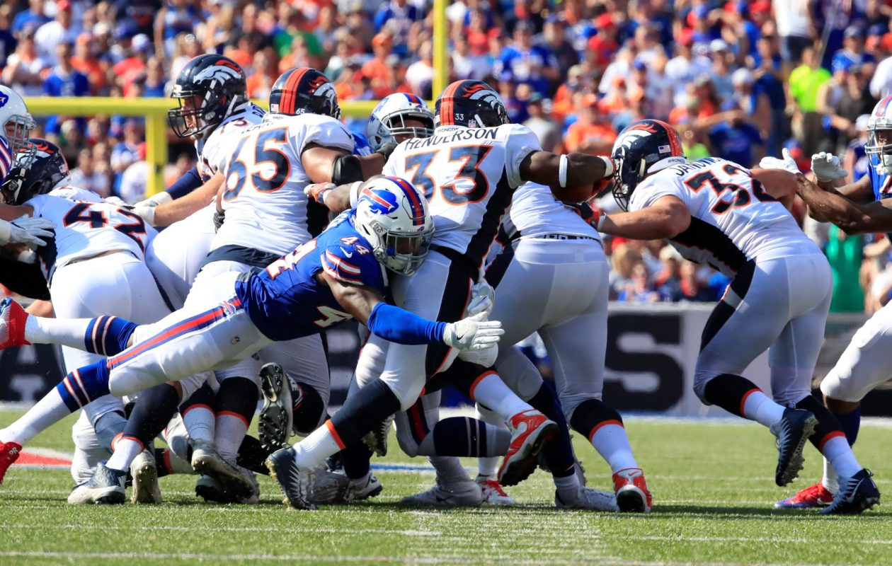 Buffalo's Deon Lacey stops Denver's De'angelo Henderson on a fake punt during the third quarter at New Era Field on Sept. 24, 2017. (Harry Scull Jr./Buffalo News)