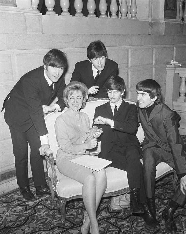 Dr. Joyce Brothers interviews the Beatles in 1964. (Copyright Bettman/CORBIS)