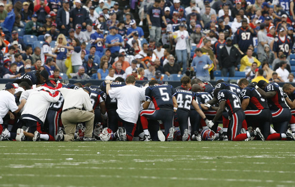 Buffalo Bills teammates pray on the field after player Kevin Everett was hurt in the game against the Denver Broncos Sept. 7, 2007, at Ralph Wilson stadium in Orchard Park (James P. McCoy/Buffalo News file photo)