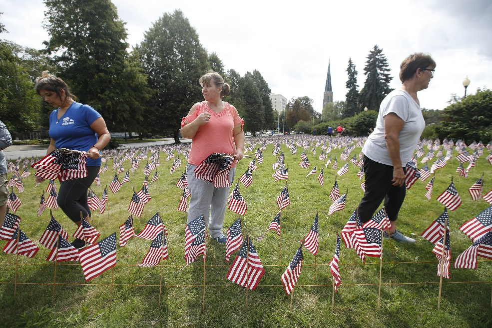 Western New York Families of Sept. 11 set up 2,996 flags, one for each victim, on the grounds of Buffalo's American Red Cross chapter on Sunday. Twenty-six of the victims had local connections. (Sharon Cantillon/Buffalo News)