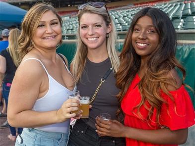 Smiles at Ballpark Brew Bash at Coca-Cola Field