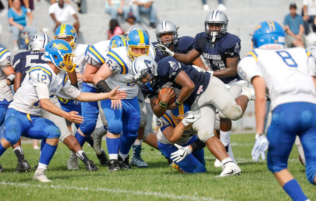 Khalil Horton rushes for the first of his two touchdowns during Lackawanna's win over Alden. (Derek Gee/Buffalo News)