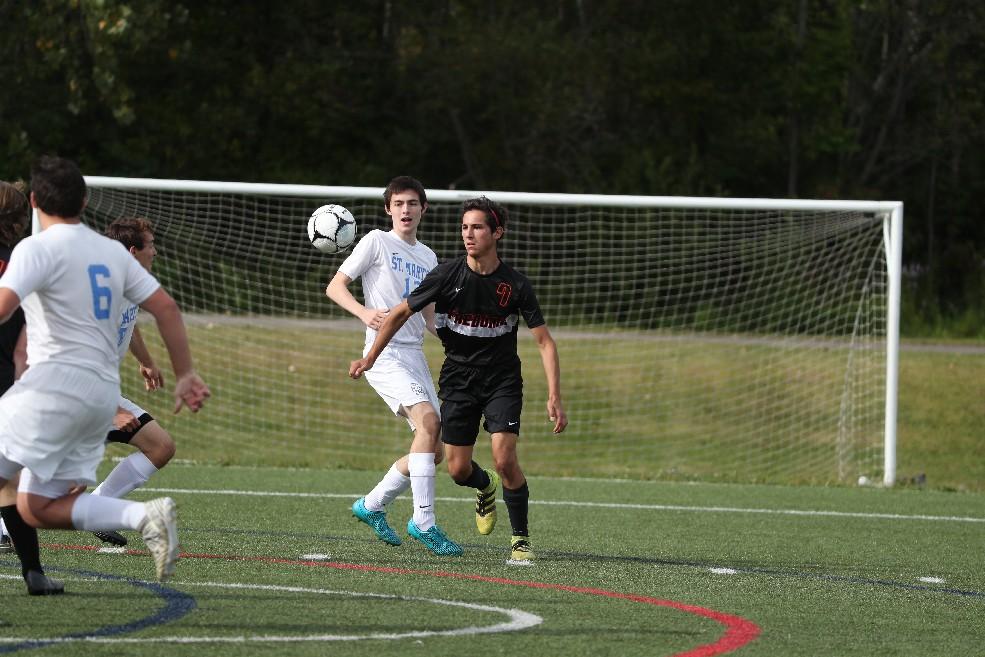 Fredonia's Jason Genovese battles St. Mary's Kyle Schaffstal for the ball. (James P. McCoy/Buffalo News)