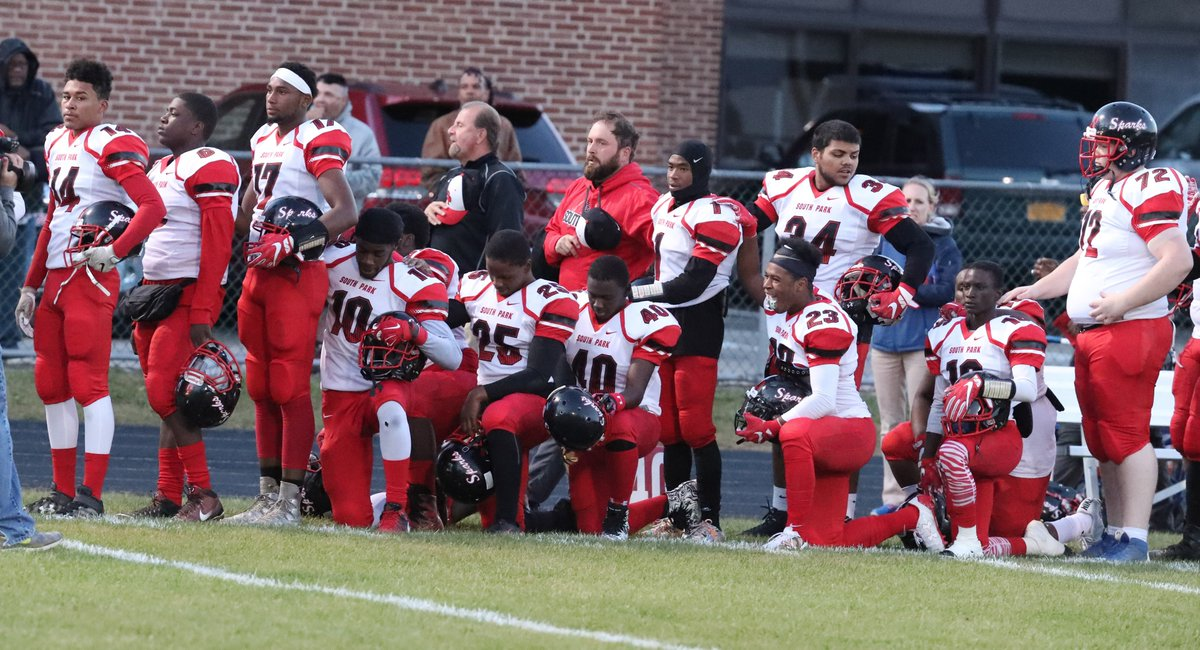 Several South Park players take a knee during the playing of the national anthem before Friday night's game at Iroquois. (James P. McCoy/Buffalo News)