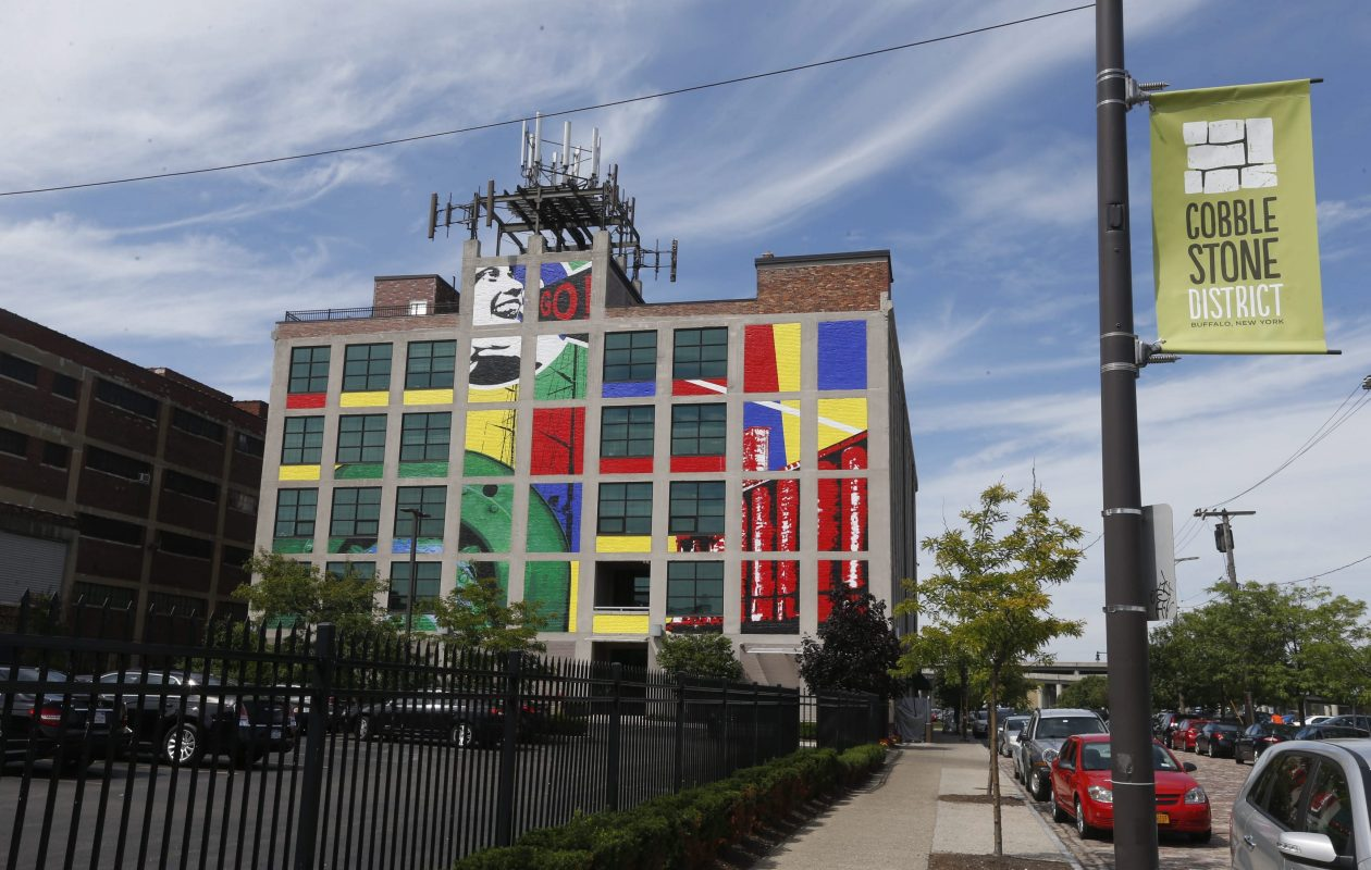 Hallwalls and UB's Art and Science cabaret will feature an appearance from artist Bruce Adams, who created this colorful mural in the Cobblestone District with Augustina Droze in 2015. (Robert Kirkham/Buffalo News file photo)
