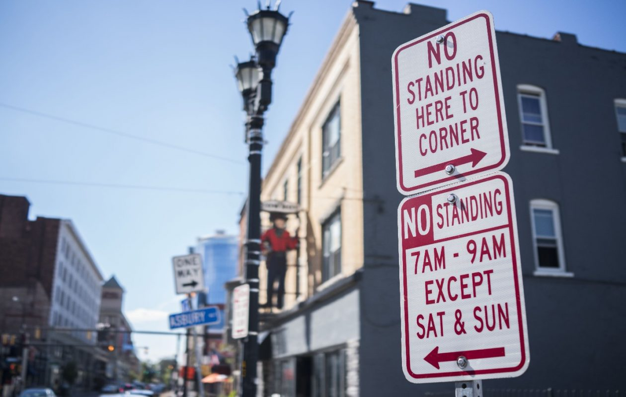 Parking signs on Chippewa Street, Friday, Aug. 18, 2017. (Derek Gee/Buffalo News)