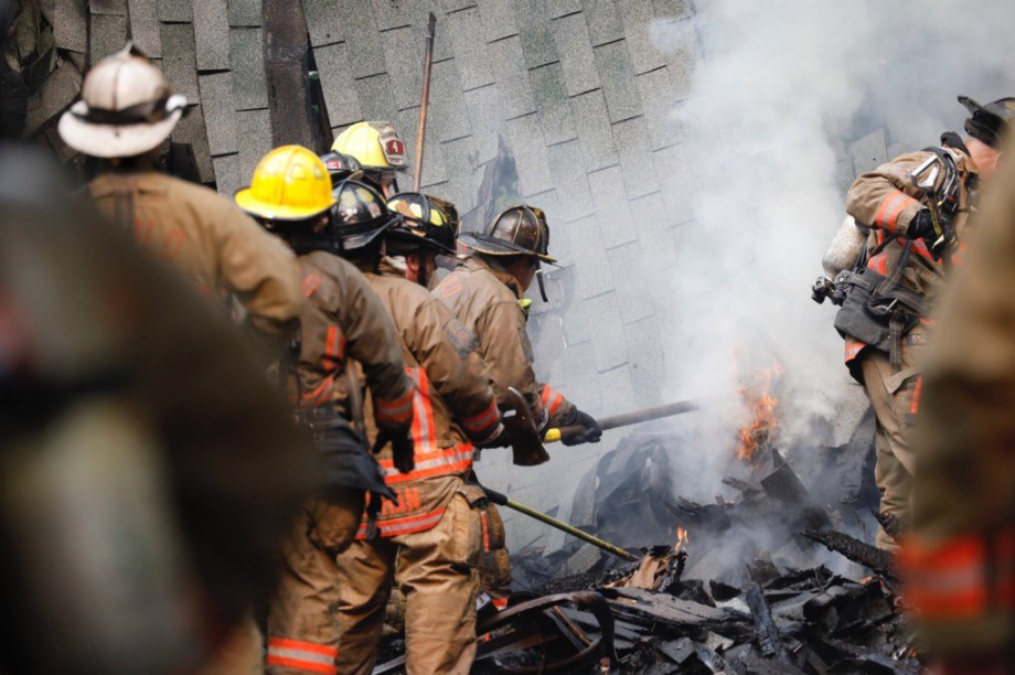 Buffalo firefighters put out hot spots where a garage collapsed in a fire Tuesday morning. (Derek Gee/Buffalo News)