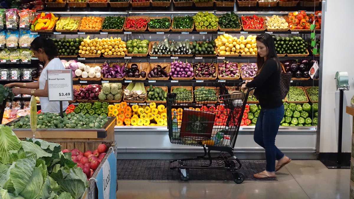 Sarah Mackey shops at the grand opening of Whole Foods Market in Amherst. (John Hickey/Buffalo News)