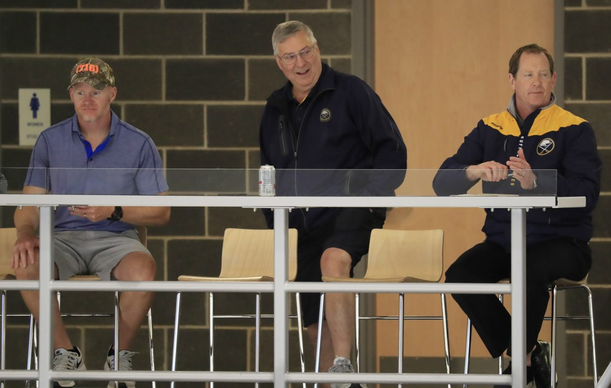 Which of Terry Pegula's coaches will see the postseason first: Sean McDermott of the Bills (left) or Phil Housley of the Sabres (far right)? (Harry Scull Jr./Buffalo News)
