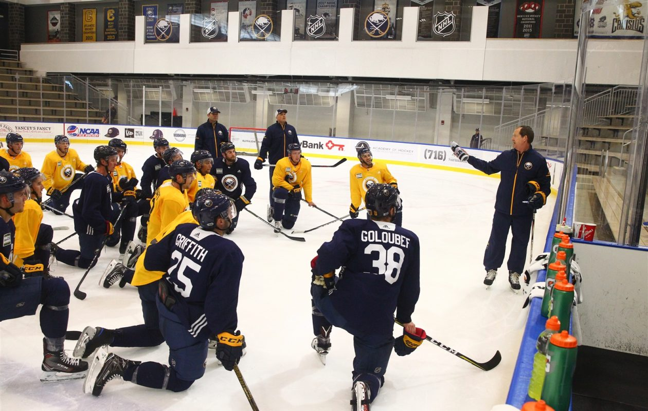 Phil Housley had the players' attention while teaching the system during training camp. (John Hickey/Buffalo News)