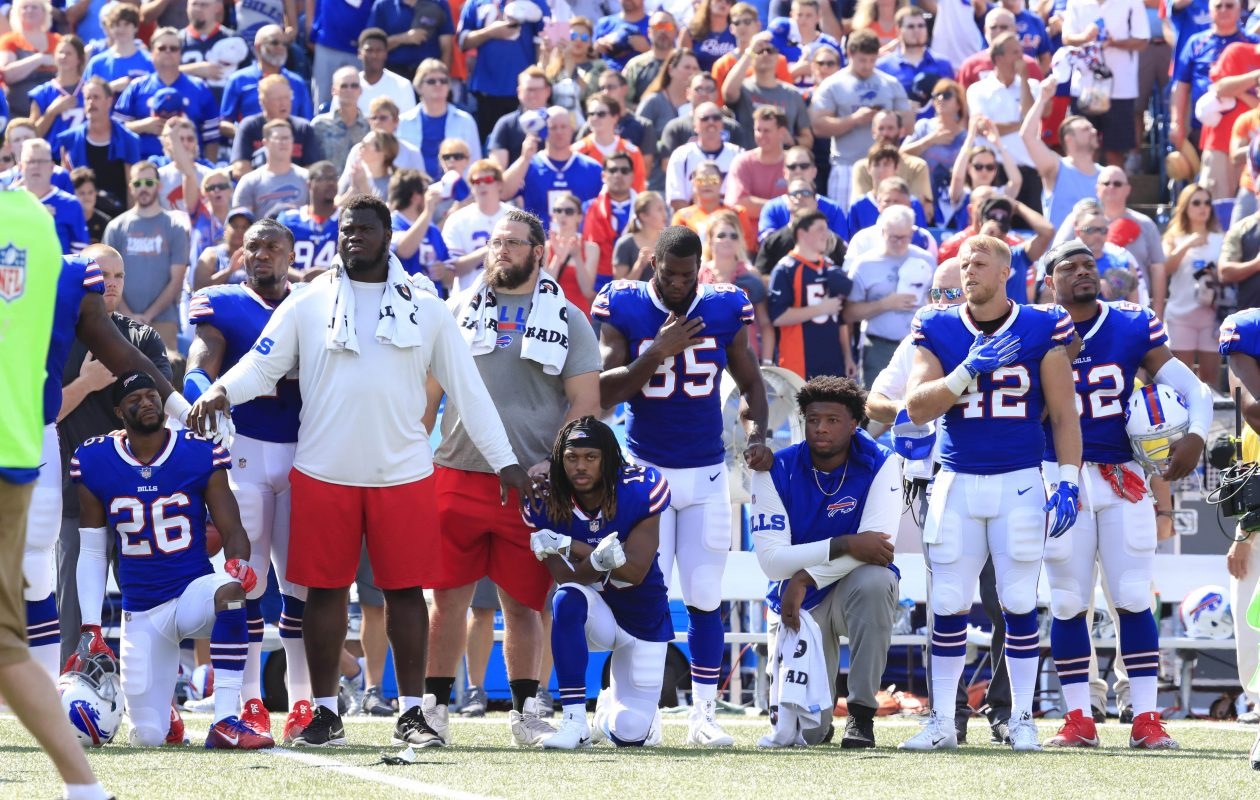 Buffalo Bills stand and kneel for the National Anthem prior to playing the Denver Broncos at New Era Field on Sunday, Sept. 24, 2017. (Harry Scull Jr./ Buffalo News)