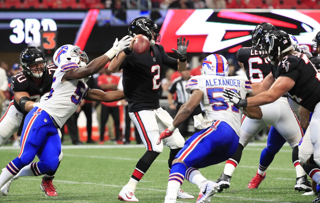 Jerry Hughes strips the ball from Matt Ryan on the play that would result in a Tre'Davious White fumble return for a touchdown. (Harry Scull Jr./ Buffalo News)