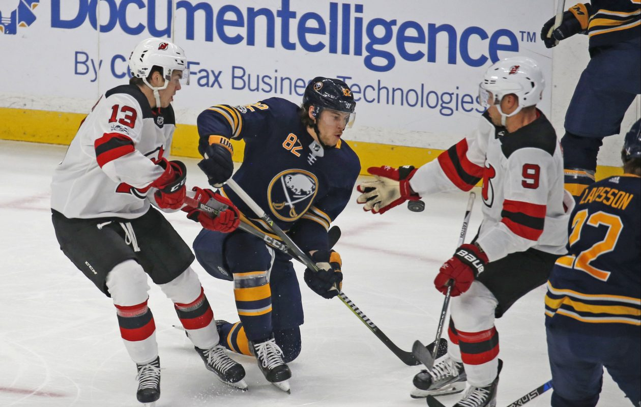 The Sabres' Nathan Beaulieu, swarmed by the Devils' Nico Hischier (13) and Taylor Hall (9), knows he is off to a rough start. (Robert Kirkham/Buffalo News)