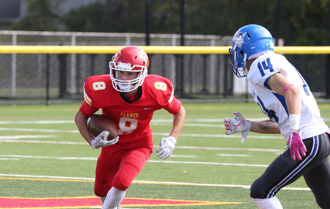 Nick Kieffer of Williamsville East picks up some yardage during the Flames' Homecoming win over Kenmore West on Saturday. (Sharon Cantillon/Buffalo News)