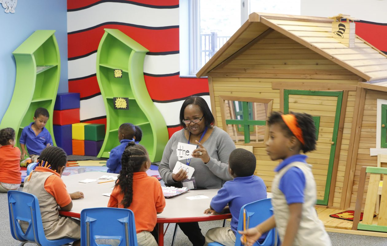 "Teacher assistant Donna Jones runs through flash cards with ""sight words"" on them during kindergarten glass in the Dr. Seuss Room REACH Academy Charter School on Tuesday, Oct. 10, 2017. (Derek Gee/Buffalo News)"
