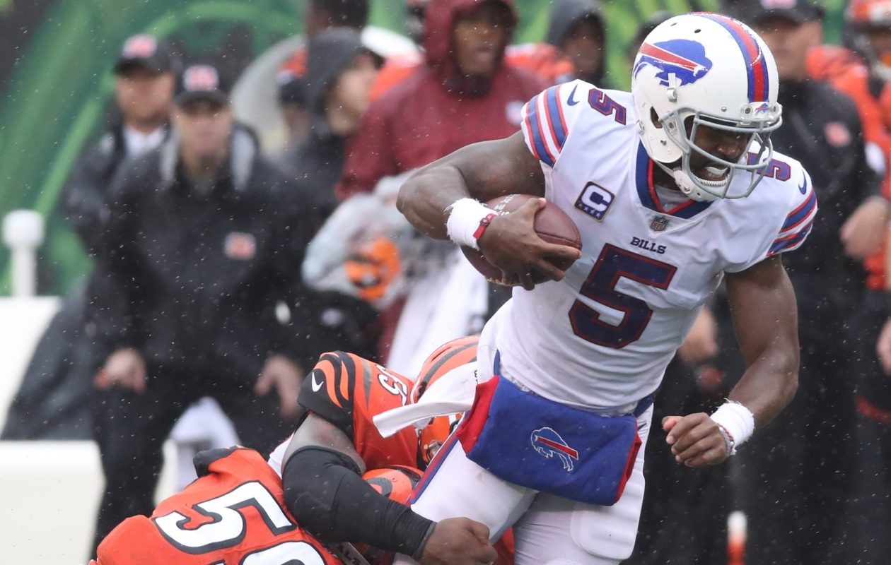 Buffalo Bills quarterback Tyrod Taylor (5) rushes for a first down over Cincinnati Bengals outside linebacker Nick Vigil (59) in the third quarter at Paul Brown Stadium in Cincinnati in Ohio on Sunday, Oct. 8, 2017.  (James P. McCoy / Buffalo News)