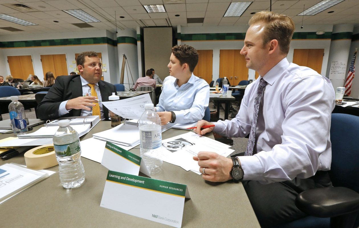 Peter Goodman, left, meets with some of his Executive Associate program classmates at M&T Center. (Robert Kirkham/Buffalo News)