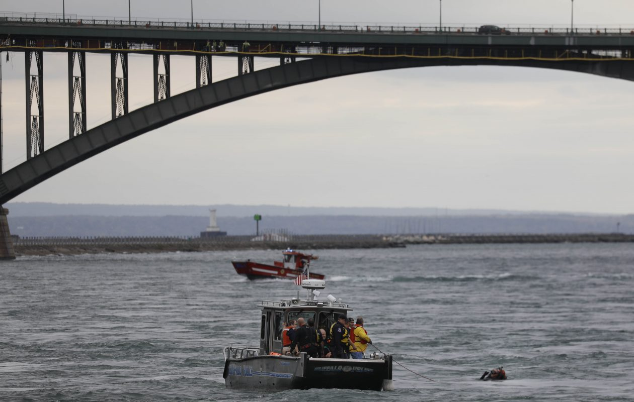 Search and rescue crews scour the Niagara River near Broderick Park at the foot of West Ferry Street Friday afternoon where Buffalo police diver Craig Lehner went missing during training exercises.  (Derek Gee/Buffalo News)