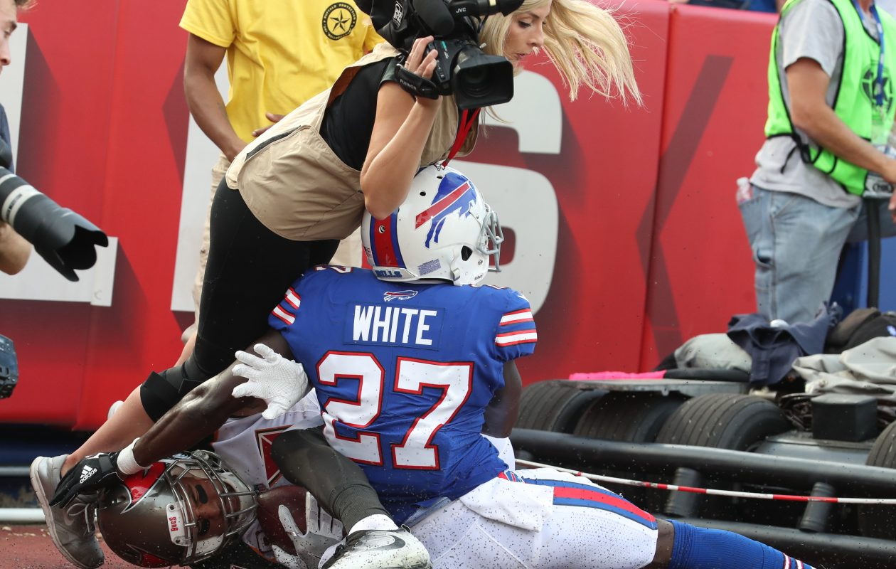 Tampa Bay Buccaneers wide receiver Mike Evans (13) catches a touchdown pass in front of Buffalo Bills cornerback Tre'Davious White (27) and knocks over sports reporter Jenna Cottrell of WHAM in Rochester in the fourth quarter. (James P. McCoy/Buffalo News)