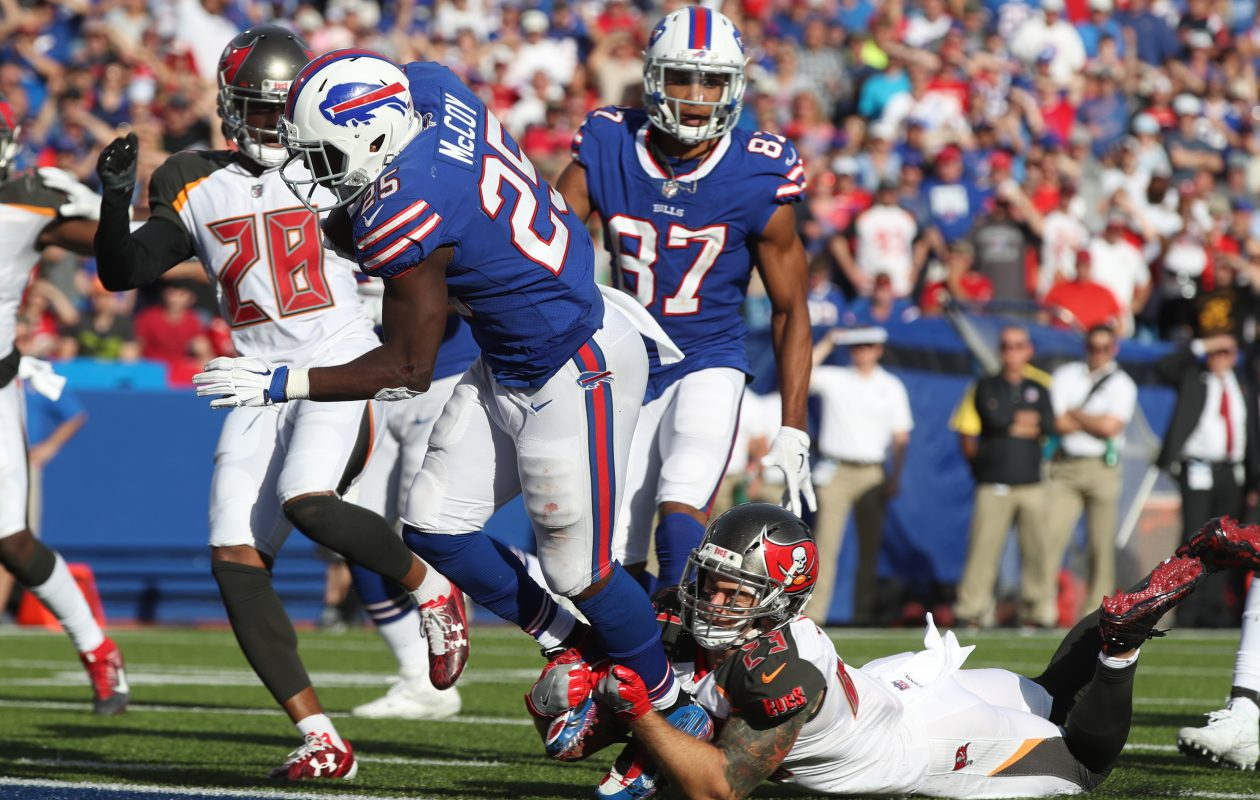 Buffalo Bills running back LeSean McCoy (25) rushes for a touchdown against Tampa Bay Buccaneers free safety Chris Conte (23) in the fourth quarter. (James P. McCoy/Buffalo News)