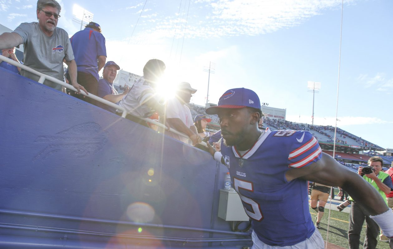 Buffalo Bills quarterback Tyrod Taylor (5) shakes the hands of fans after beating the Tampa Bay Buccaneers. (James P. McCoy/Buffalo News)