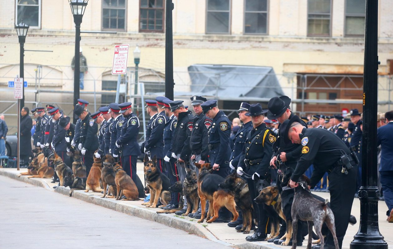 K-9's and police officers from across North America get ready to salute the flag-drapped casket of Buffalo police Officer Craig E. Lehner on Perry Street, in Buffalo,  N.Y., on Wednesday,Oct. 25, 2017. Lehner died in a diving accident in the Niagara River on Oct. 13.  (John Hickey/Buffalo News)