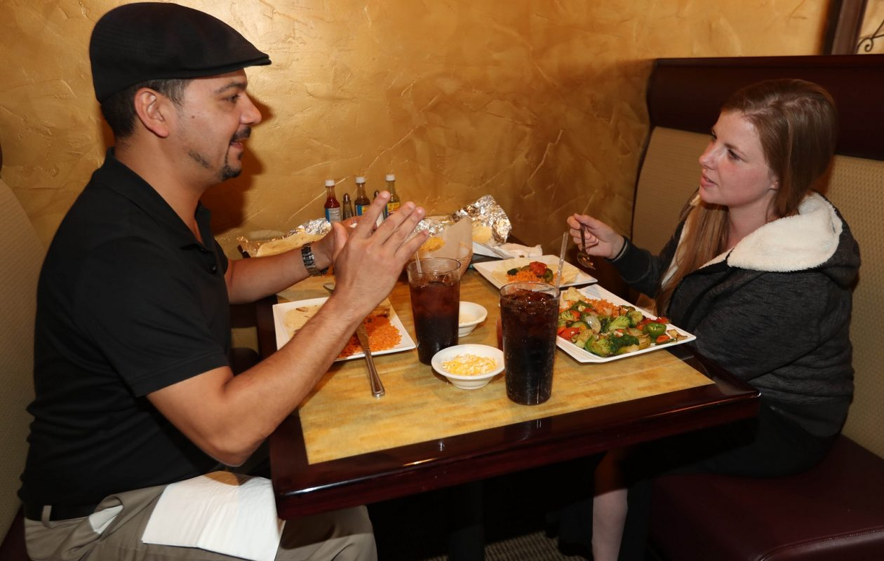 Walter Ponce, left, and Kelly Brady of South Buffalo eat lunch at El Ranchito. (Sharon Cantillon/Buffalo News)