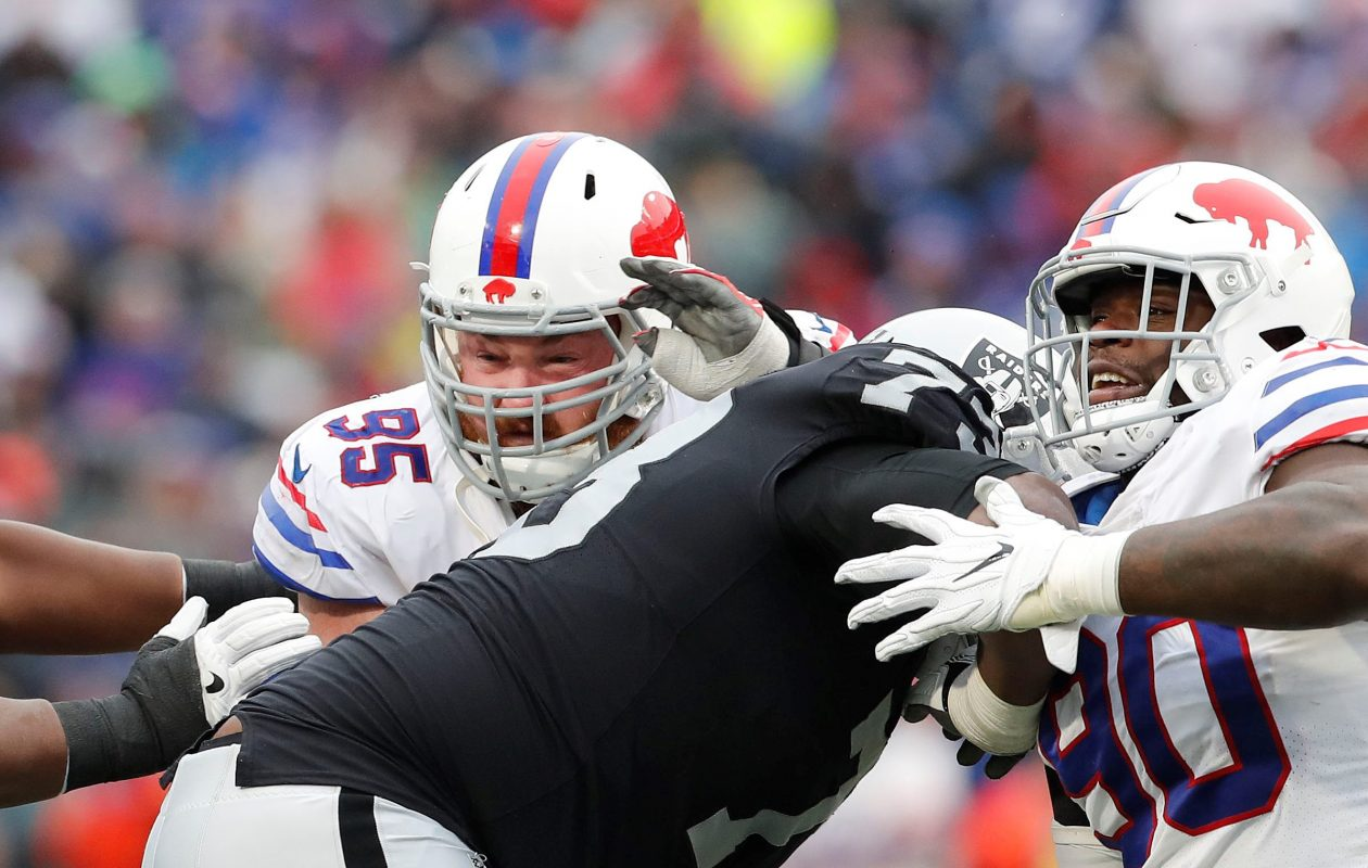 Kyle Williams works to get past Oakland Raiders' Marshall Newhouse during the fourth quarter. (Mark Mulville/Buffalo News)