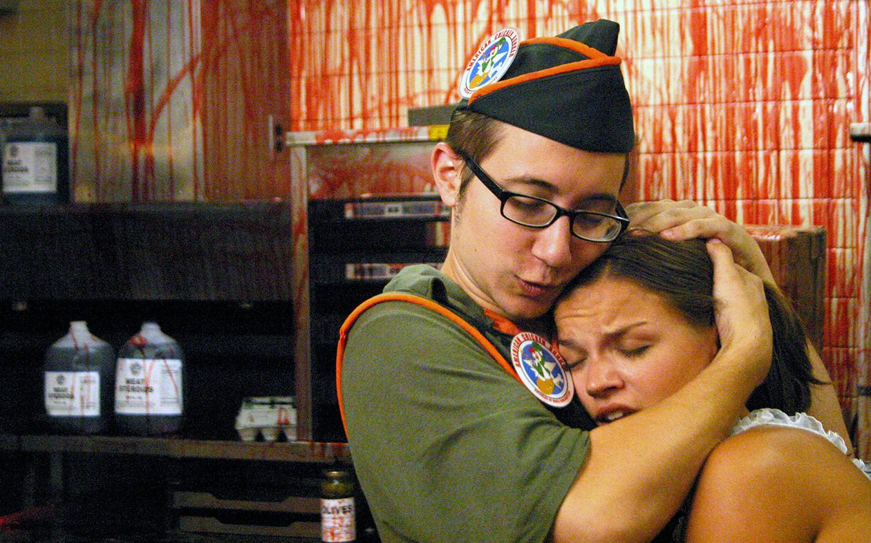 "Jason Yachanin and Kate Graham together as Arbie and Wendy in ""Poultrygeist: Night of the Chicken Dead."""