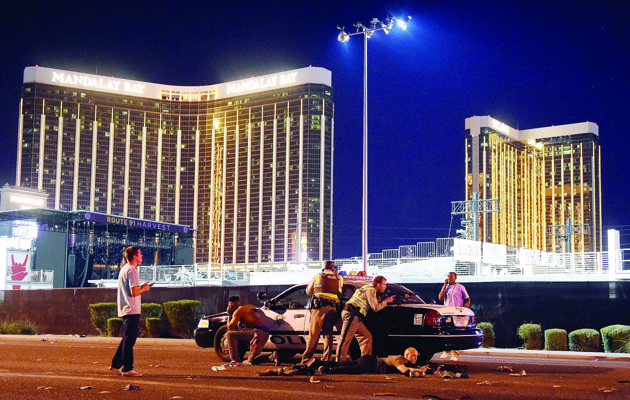 Las Vegas police stand guard along the streets outside the Mandalay Bay Resort and Casino. in this file photo (Photo by David Becker/Getty Images)