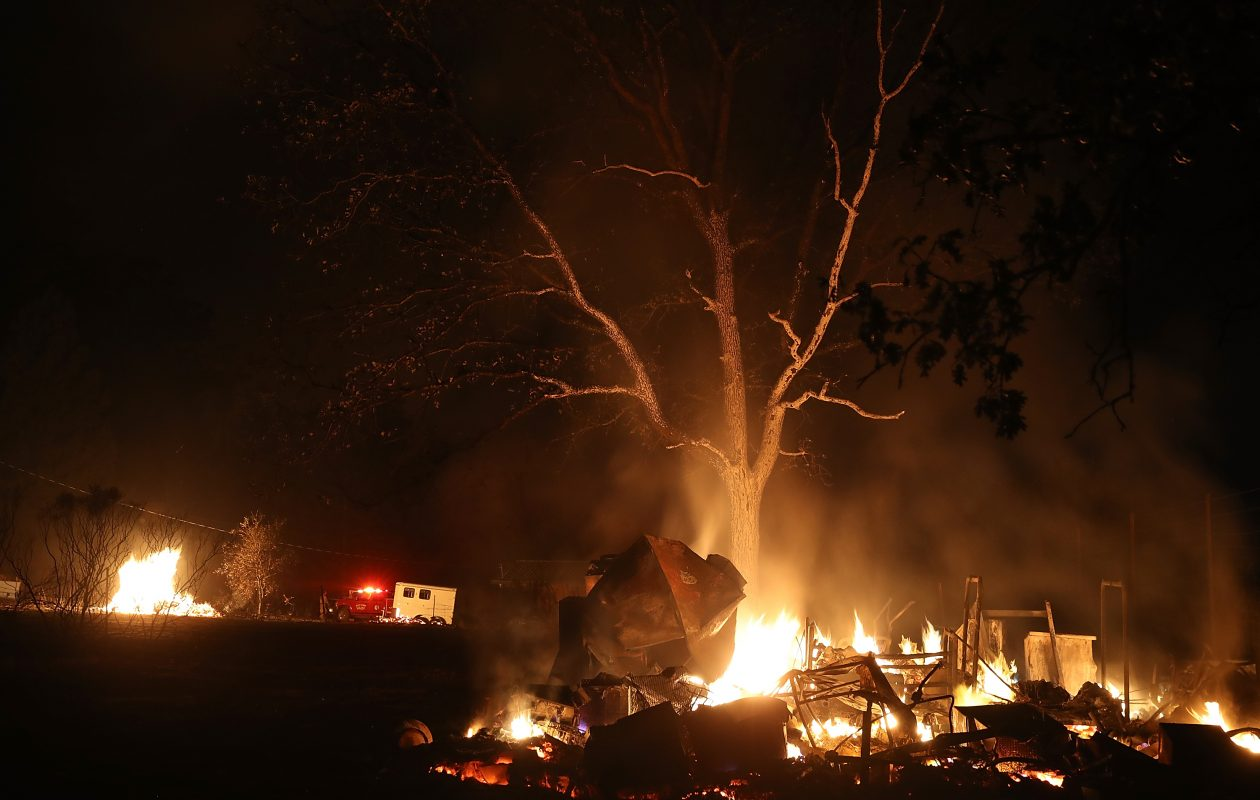 A pile of furniture burns during the Nuns Fire Monday in Kenwood, California. At least 17 people have died in wildfires that have burned tens of thousands of acres and destroyed over 2,000 homes and businesses in several Northern California counties.  (Photo by Justin Sullivan/Getty Images)