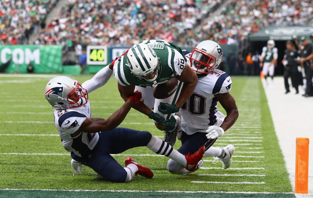 Tight end Austin Seferian-Jenkins #88 of the New York Jets is seen fumbling the ball after what was originally called a touchdown against strong safety Duron Harmon #30 and cornerback Malcolm Butler #21 of the New England Patriots during the fourth quarter. (Getty Images)