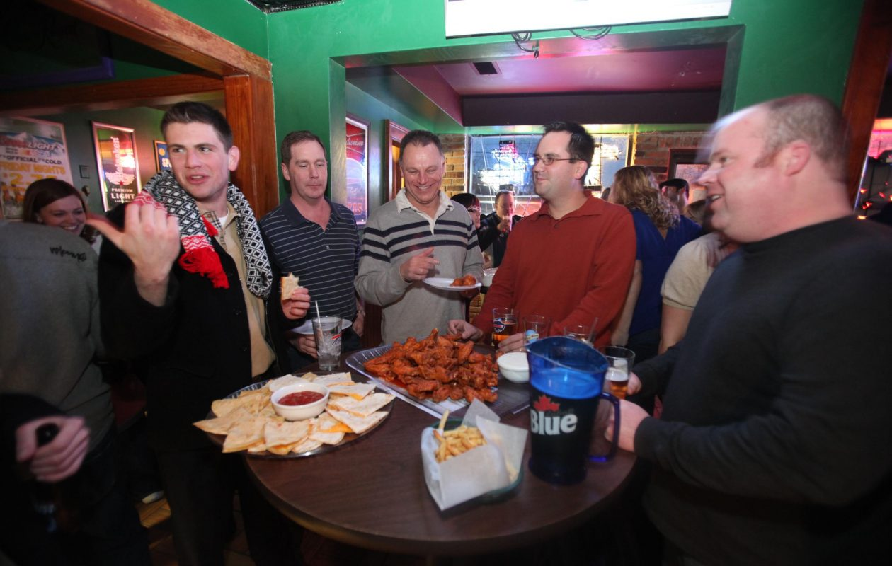 Patron's at Average Joe's chat over wings and adult beverages in this 2010 photo. A developer plans to build townhomes on the site of the Amherst tavern. (Robert Kirkham/Buffalo News)
