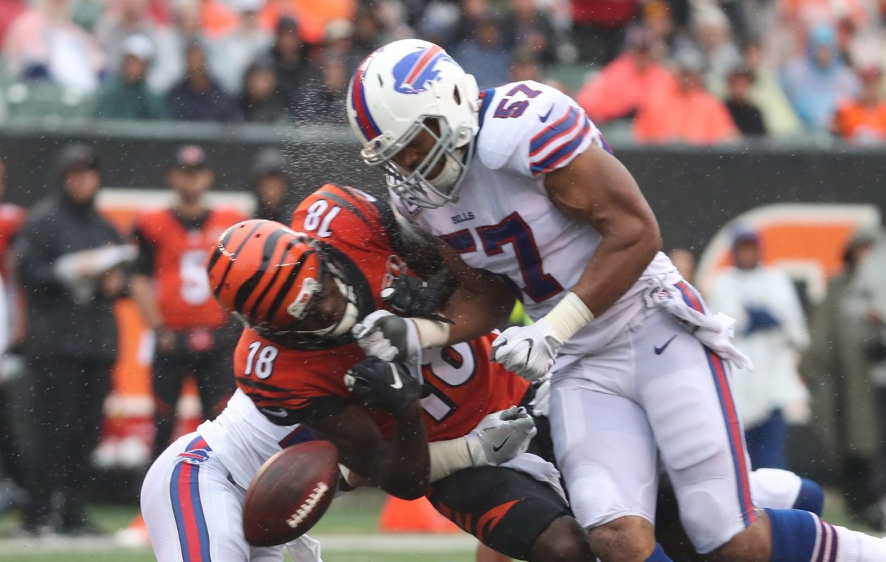 Buffalo Bills outside linebacker Lorenzo Alexander (57) hammers Cincinnati Bengals wide receiver A.J. Green (18) and forces a fumble in Sunday's game between the Bills and the Bengals. (James P. McCoy/Buffalo News)
