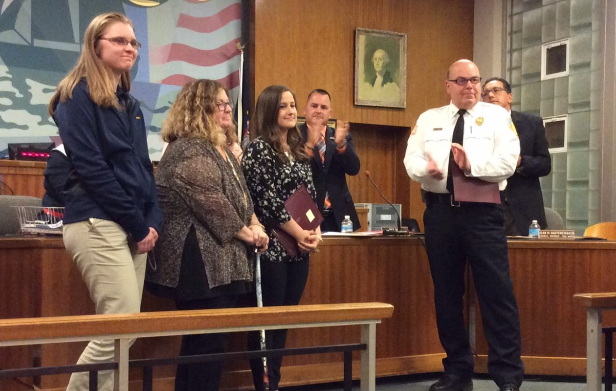 City of Tonawanda honors those who helped to rescue a 102-year-old woman from a fire with a proclamation and standing ovation (left to right) Annie Draves, Patricia Bachman, Larissa Bachman, Mayor Rick Davis in background and Fire Chief Charles Stuart.