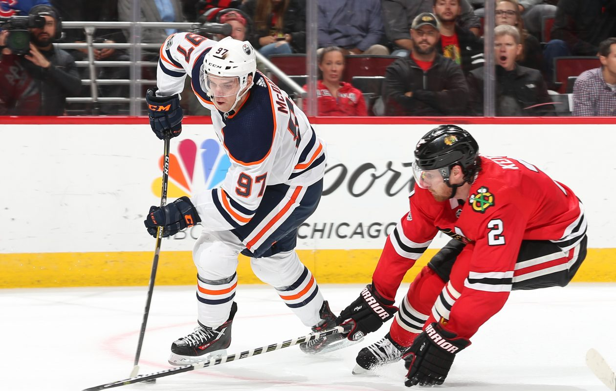 Connor McDavid #97 of the Edmonton Oilers and Duncan Keith #2 of the Chicago Blackhawks battle for the puck in overtime at the United Center on October 19, 2017 in Chicago. The Edmonton Oilers defeated the Chicago Blackhawks 2-1.  (Getty Images)