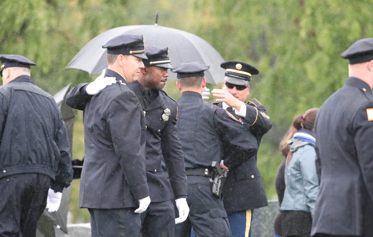 Buffalo police officers at the gravesite of Buffalo Police officer Craig Lehner at Forest Lawn in Buffalo on Wednesday, Oct. 25, 2017.  (James P. McCoy / Buffalo News)