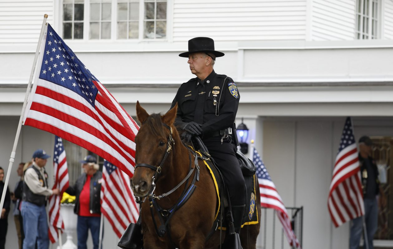 An Erie County Sheriff Mounted unit is stationed outside the Lakeside Memorial Funeral Home in Hamburg to pay tribute to fallen BPD Officer Craig Lehner, Monday, Oct. 23, 2017.  (Derek Gee/Buffalo News)