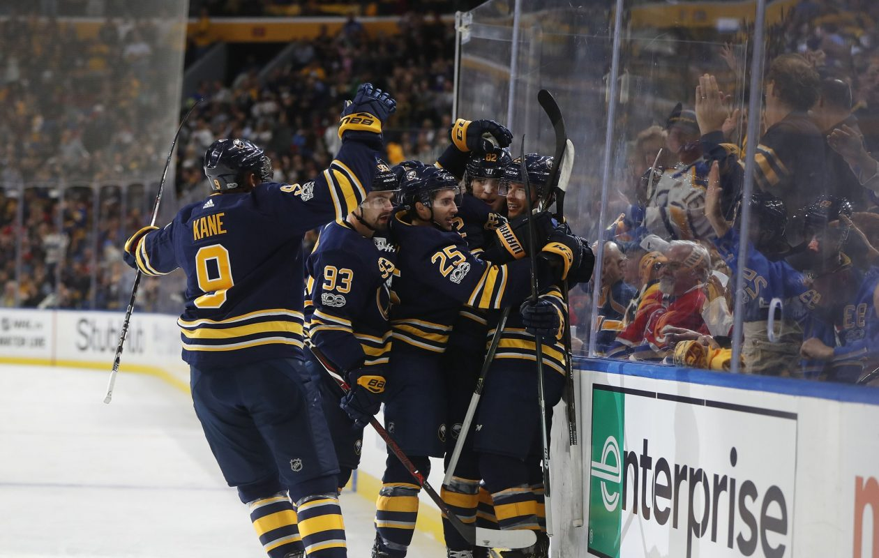 Jason Pominville, right, feels the love after scoring Buffalo's first goal Thursday. (Mark Mulville/Buffalo News)