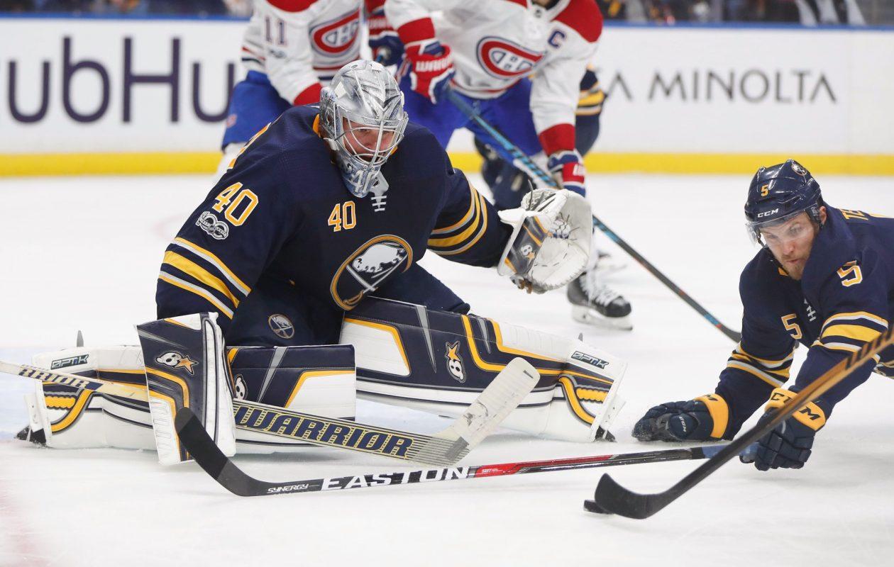 The Sabres' Robin Lehner (40) and Matt Tennyson hit the ice to block a shot Thursday. (Mark Mulville/Buffalo News)